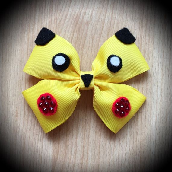 Pikachu Pokemon Character Inspired Yellow Hair Bow. Pokemon Go.  Yellow Grosgrain Ribbon Decorated with Black and Red Felt Details and Red Rhinestones.  Mounted on an alligator clip.  I can do custom bows, just let me know if youd like something specific.  Price is for single bow.