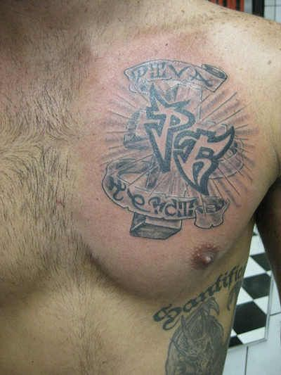 Pin by tattoos on hot men chest tattoos for Initial tattoos for guys