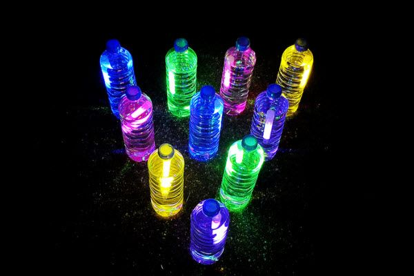 """""""Glow bowling"""" with glow sticks and water bottles- Glow in the Dark: 15 Neon Birthday Party Ideas - ParentMap"""