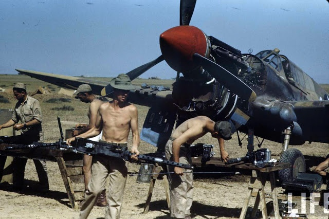 vintage everyday: Color Photos of Tunisia and Libya in the North African Campaign of World War II, 1943 Dismantiling a Stuka dive bomber.