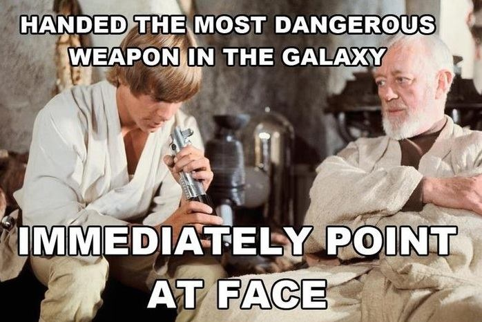 and then turns it on and almost chops off Obi-Wan's head