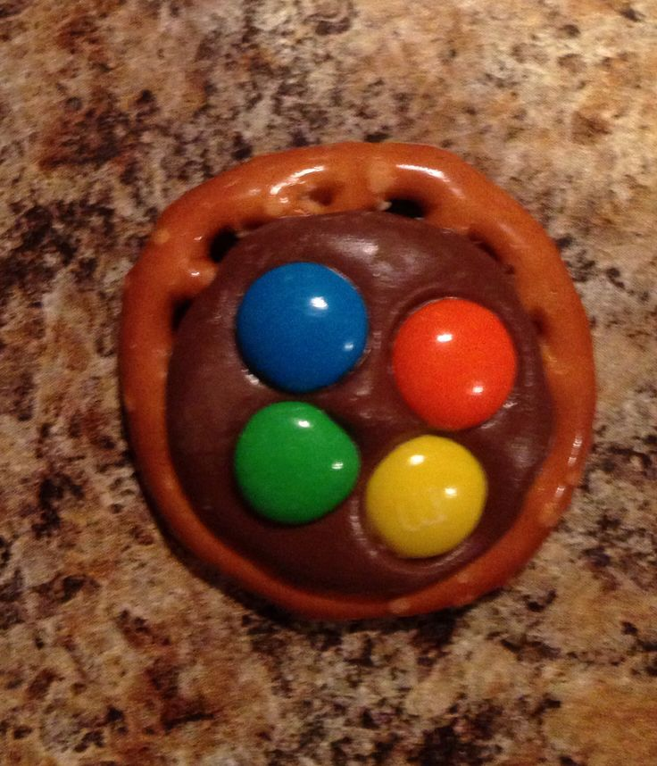 Pete the cat and his four groovy buttons snack. Round pretzels with chocolate wafer and 4 mini m&ms.  Yummy!!