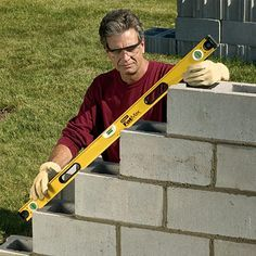 Building a cinder block retaining wall.  I'd use this as a guideline for building an outdoor bar base.