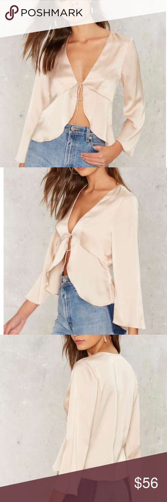 Nasty gal satin tie front blouse Size medium new with tags satin shirt, super cute with jeans or a pencil skirt! Original price is 68 and it's sold out on nasty gals website so please no low ball offers! Nasty Gal Tops Blouses