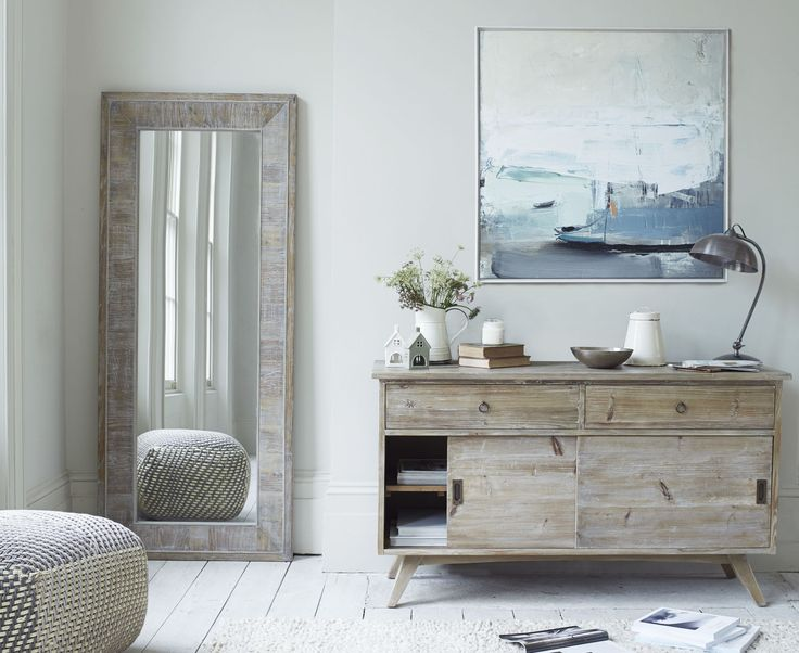 How to style your sideboard: This lovely rustic, worn-in finish is a nice nod to mid-century design. It's made from solid reclaimed fir recovered from old buildings. Hoot sideboard, £595, Loaf. Find more ideas at housebeautiful.co.uk