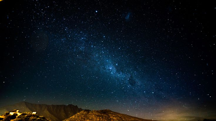 1366x768 Wallpaper starry sky, night, mountains, radiance, glitter