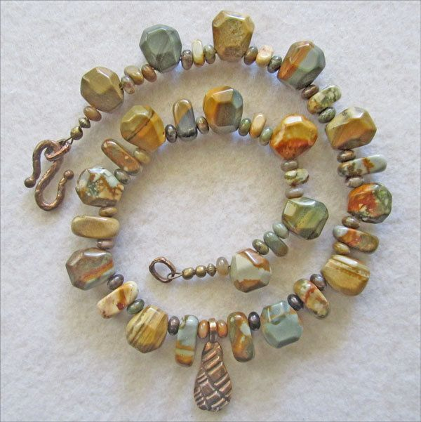 Necklace in soft shades of teal, sand, and terra cotta - pinned by pin4etsy.com