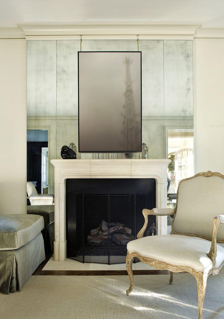 Robert Brown Interior Design | Atlanta mirrored fireplace wall