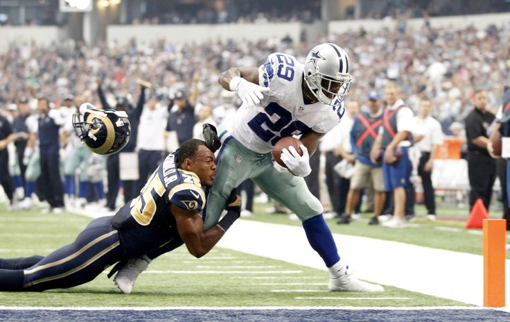 Dallas Cowboys running back DeMarco Murray scores a touchdown while being tackled by St. Louis Rams strong safety T.J. McDonald. (Tim Heitman/USA TODAY Sports)