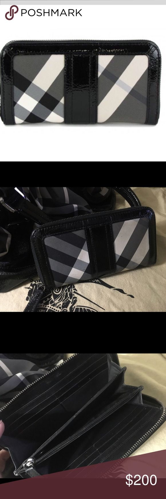 Burberry Beat Check Black Nylon Zip Around Wallet Black, charcoal and white nylon Burberry Beat check zip wallet with black leather trim, twelve card slots, dual wall slip pockets, center zip pouch and zip-around closure. Great condition! Also have matching tote listed! Burberry Bags Wallets