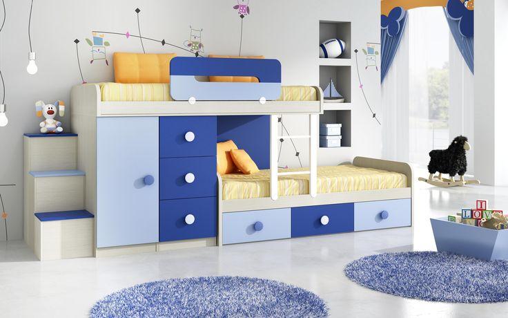 Dormitorio infantil MadriDecor. Aprovechamos los espacios creando sitios de descanso,lugares de juego y estudio pensando en los reyes de la casa