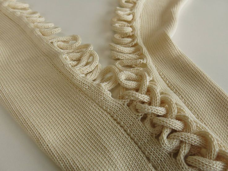 knitted zip like closure, saw it on a Russian machine knit designers work years ago and loved it