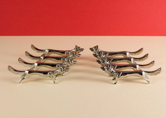 A set of high quality French vintage knife rests, eight beautiful silver foxes. Perfect for that festive table; birthdays, Thanksgiving or Christmas, these lovely items are designed to protect your special tablecloth from soiled cutlery or chopsticks. The foxes are made from a white base metal which are plated to add a touch of luxury. Overall condition is extremely good, only a few minor signs of use, see photos for more details.  Length (approx.): 8.5cm or 3 1/4. Weight (total): 295g.