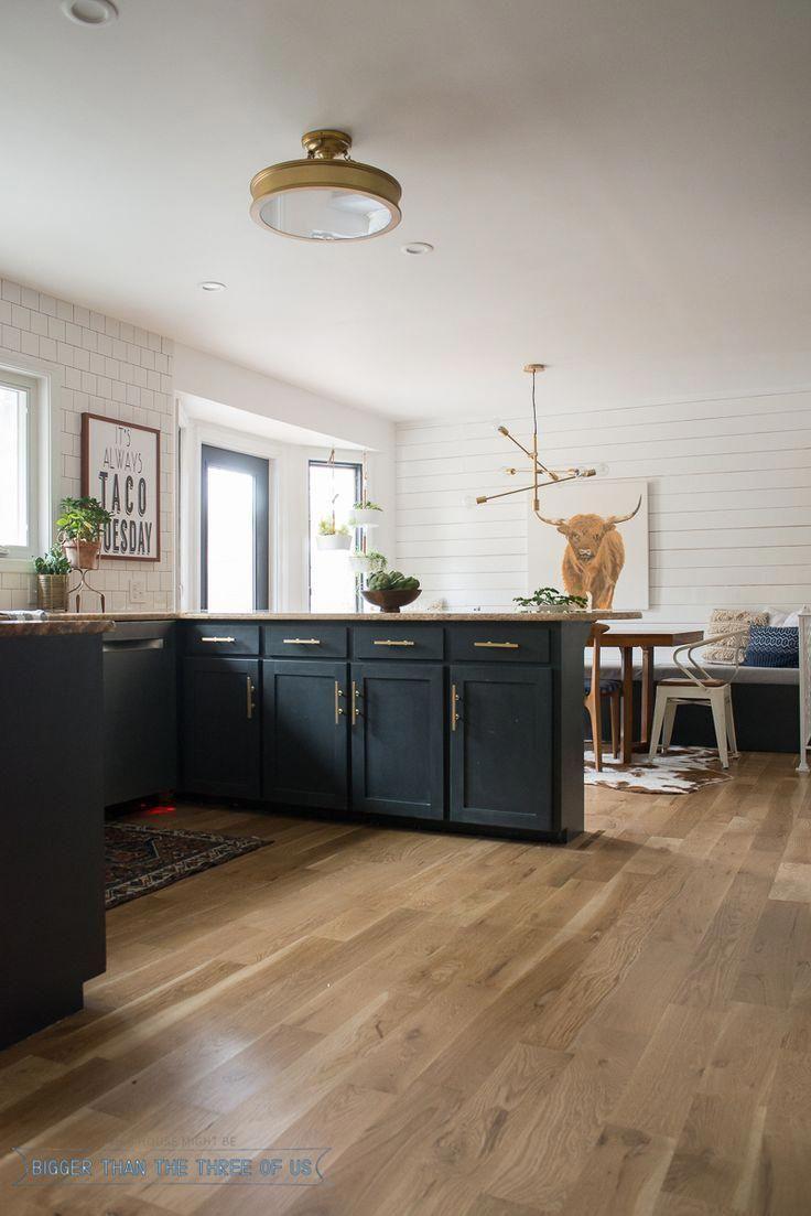 Black kitchen cabinets, brass bar pulls, shiplap, wood ...
