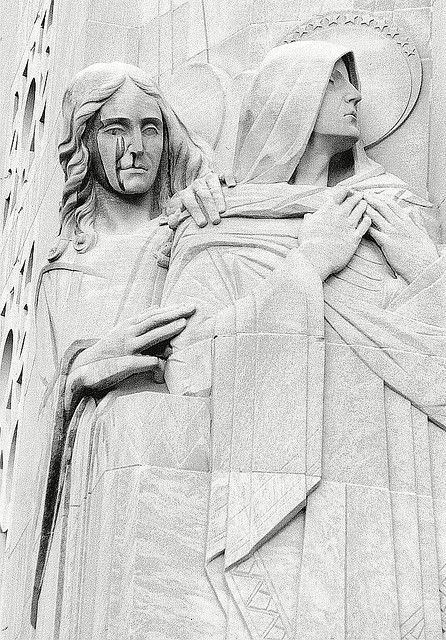 These figures are sculpture by Rene Paul Chambellan at the tower of the National Shrine of the Little Flower--the church of controversial 1930s radio priest, Father Charles Coughlin.
