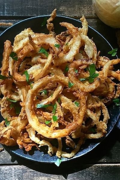 Thinly sliced and more like onion straws or onion strings, easy Southern Style Crispy Onion Rings are extra crispy and extremely flavorful delectable morsels!  via @gritspinecones