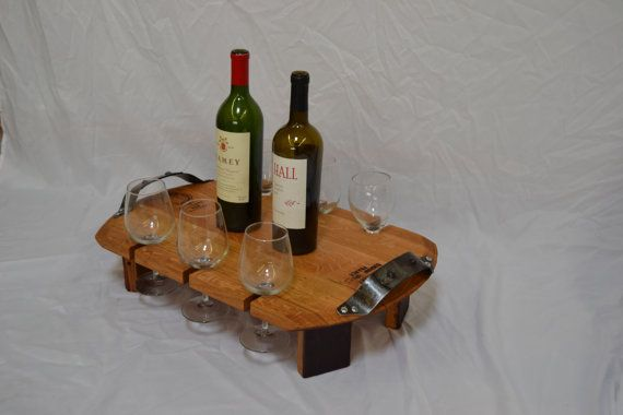 This tray is made completely from a retired wine barrel. The tray is handcrafted from the barrel head while the handles are shaped from the metal