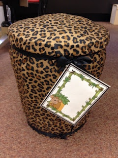 Bucket seats made out of buckets, pillow cases, and ribbon. Space inside the bucket may be used to store items, and the card on the outside used to identify the contents, or the students who need the access to what is inside.