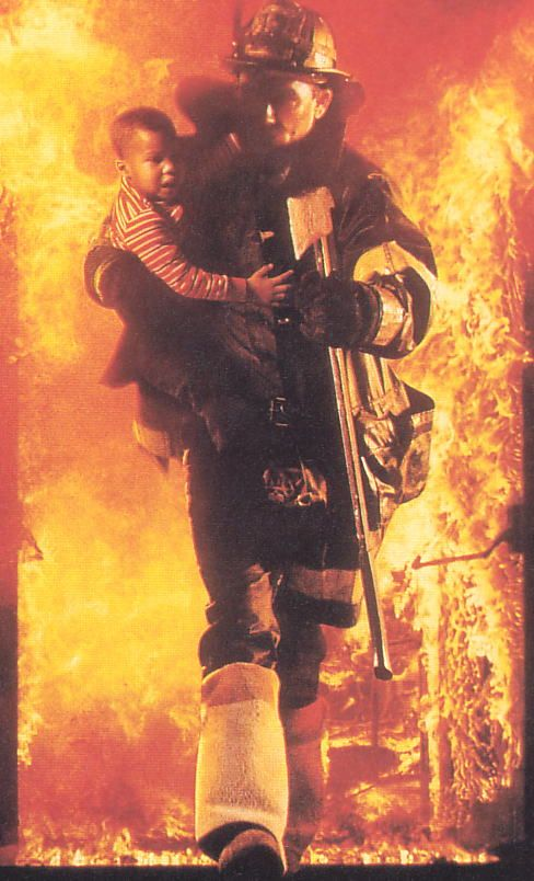 "Steven ""Bull"" McCafferey miraculously exiting a post-flashover apartment with a child on his hip in the movie Backdraft"