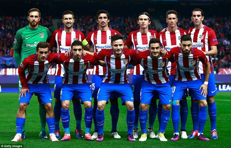 The Atletico Madrid starting XI pose for the team photo ahead of their game against FC Rostov at Vincente Calderon