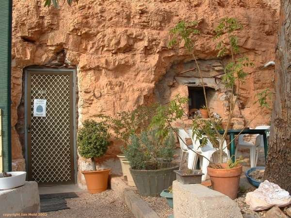 Gallery - Living Down Under Front of dugout home, Coober Pedy.