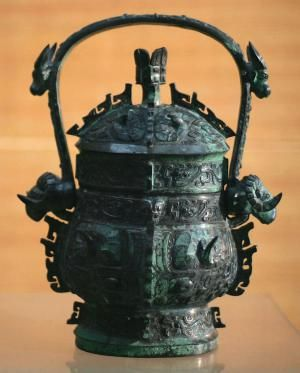 Zhou Dynasty, China (1046-221 BC): Early Western Zhou bronze you (liquid container with arch-shaped movable handle). Baoji, Shaanxi Province, China. -- http://www.suntzulives.com/