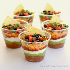 Mini seven layer dip. Great idea to keep a big dish of