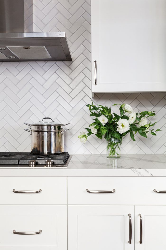 A Herringbone Pattern Beautifully Showcases Our Daisy Glazeu0027s Handcrafted  Color Variation, Lending Textured Nuance To This Bright White Kitchen.