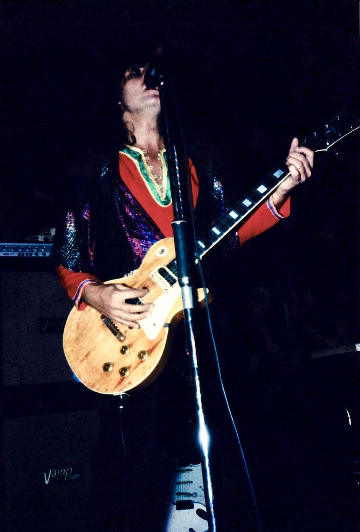 T. Rex playing the Sportpalast, Berlin, Germany, February 13, 1973. I've never seen this outfit on Marc before and I think it's fabulous! This is classic Bolan in vivid, glittering lurex with his precious Les Paul in front of a stack of Vamp amps.
