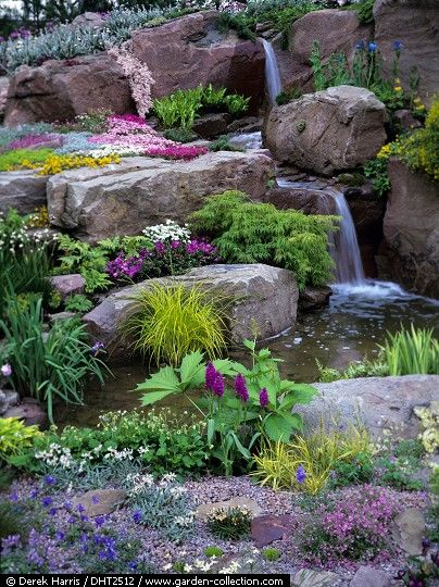 Good example of large water feature in an alpine setting done well.   Stones and boulders should be of the same rock type/color and weathering, and be planted in such a way as to suggest they are the weathered portion of a massive formation just below. This is especially true with water features, since rock is always exposed by the erosion of water courses.