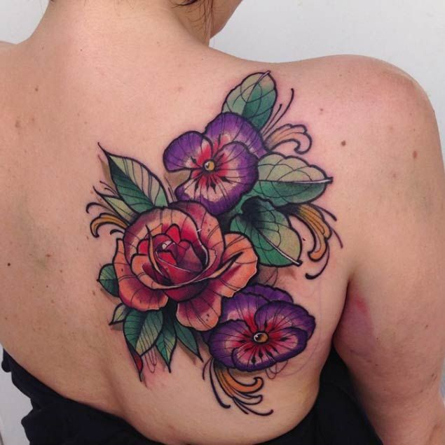 Share Tweet Pin Mail There's nothing more beautiful than a floral watercolor tattoo done right. The soft, edgeless lines and bleeding colors combine for ...