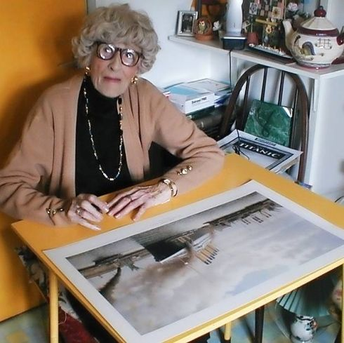 The last survivor of the Titanic Millvina Dean with the picture that will be auctioned off. Description from northdevongazette.co.uk. I searched for this on bing.com/images
