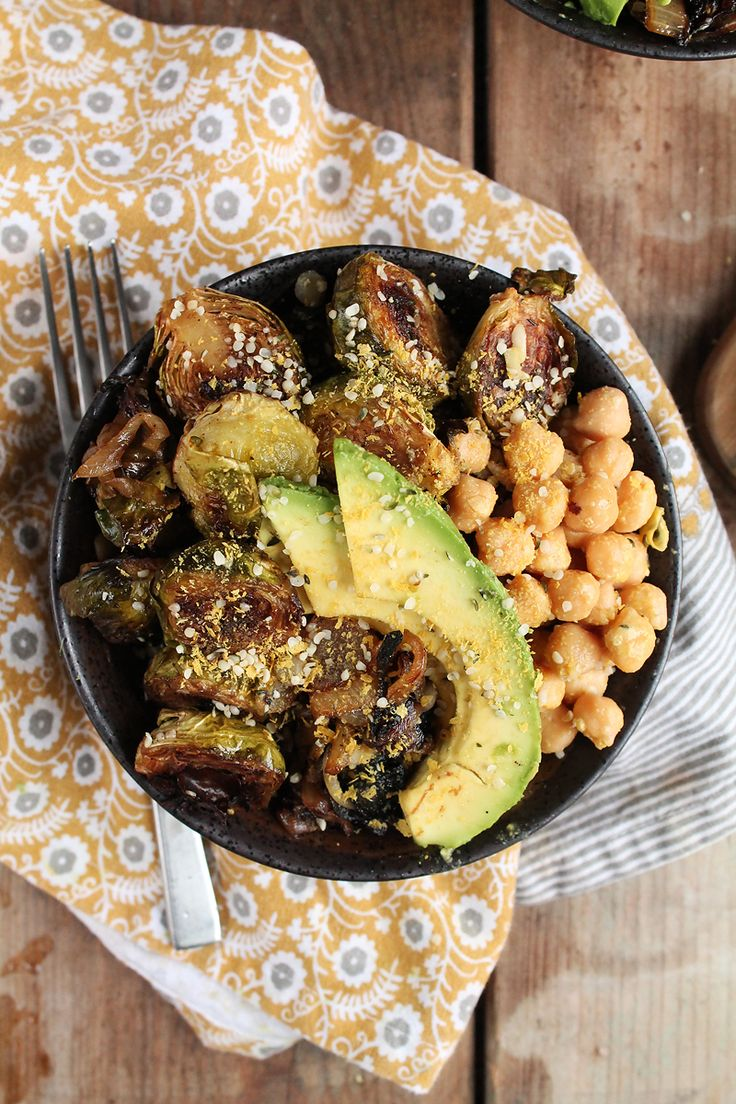 This Roasted Brussels Sprouts Buddha Bowl is filled with perfectly roasted vegetables and seasoned chickpeas for a hearty, healthy, and delicious meal.