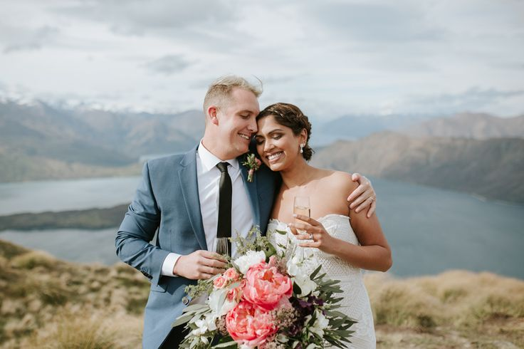 Celebrations are in order for Priya and Ben after their Mount Roy wedding, beautifully captured bt Alpine Image Company