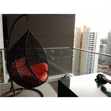 Black Outdoor Hanging Chair with Orange Cushions