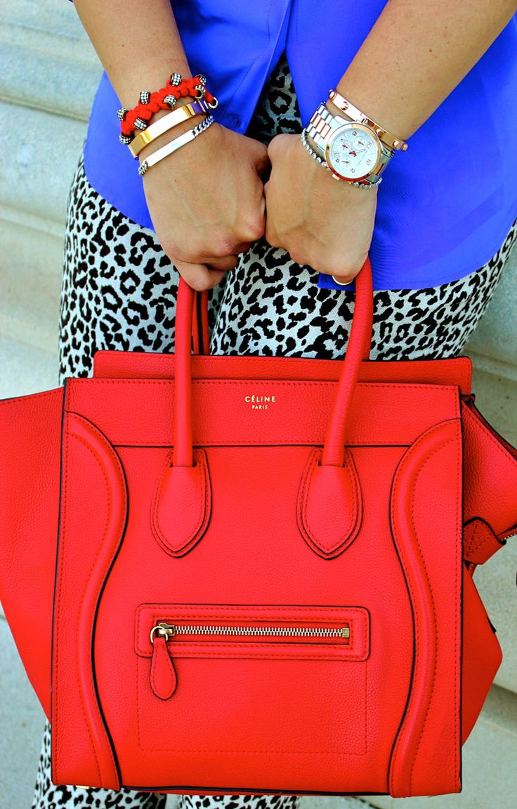 Red Celine. OMG ...I don't know what came over me last night. But the Nordstrom sales woman and I hit it off...she was so sweet...and I was asking about Celine bags. Before I knew it...she brought out this bag....and I handed over my Visa. gasp...gasp...having heart palpitations....gasp...gasp.