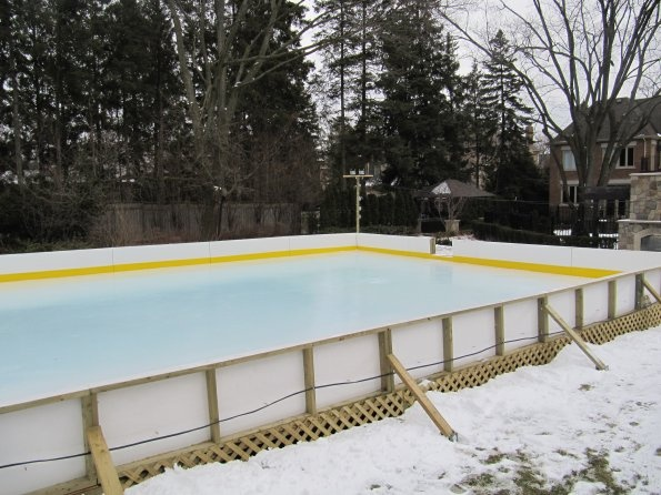 Backyard Ice Rink. Natural Ice Rink With Boards