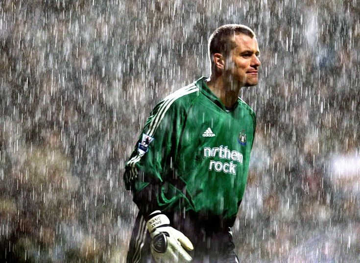 Newcastle United goalkeeper Shay Given stands in the torrential rain during his side's match against Birmingham City at St James' Park in 2005.