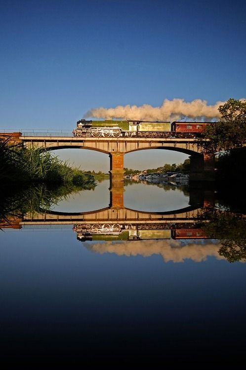 The Tornado ~ A great reflection is cast upon the water of the train they call Tornado, somewhere in England ~ Photo by...?