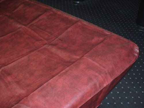 Pro Series Leatherette 8 Foot Pool Table Cover Color: Burgundy by Cue and Case. $51.00. The Pro Series Leatherette 8 Foot Pool Table Cover protects your felt from fading and helps keep the playing surface clean. The Pro Series Leatherette 8 Foot pool table cover is made with nylon backing so that there is no messy fuzz on your table and has double stitched reinforced corners for more durability.. Save 31%!