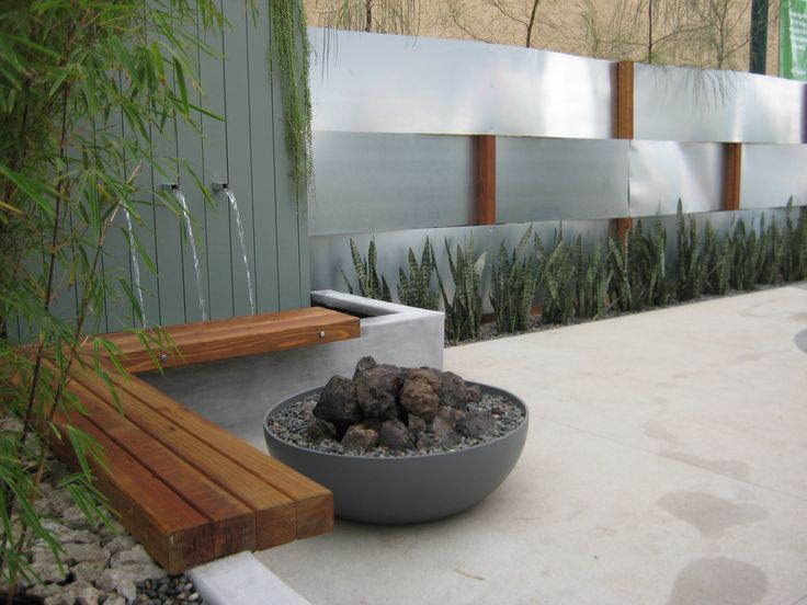 Google Image Result for http://www.fallingwatersweb.com/blog/wp-content/uploads/2009/06/img_6235.jpg  Corner bench, water feature, and fire pit