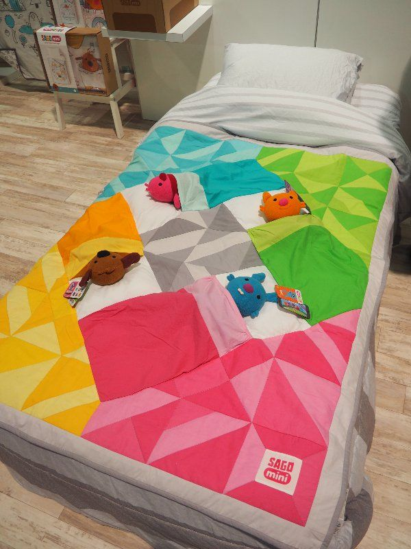 Perhaps the most adorable item we saw was Sago Mini's new Tuck Me In Quilt ($100). Created by the dad behin...