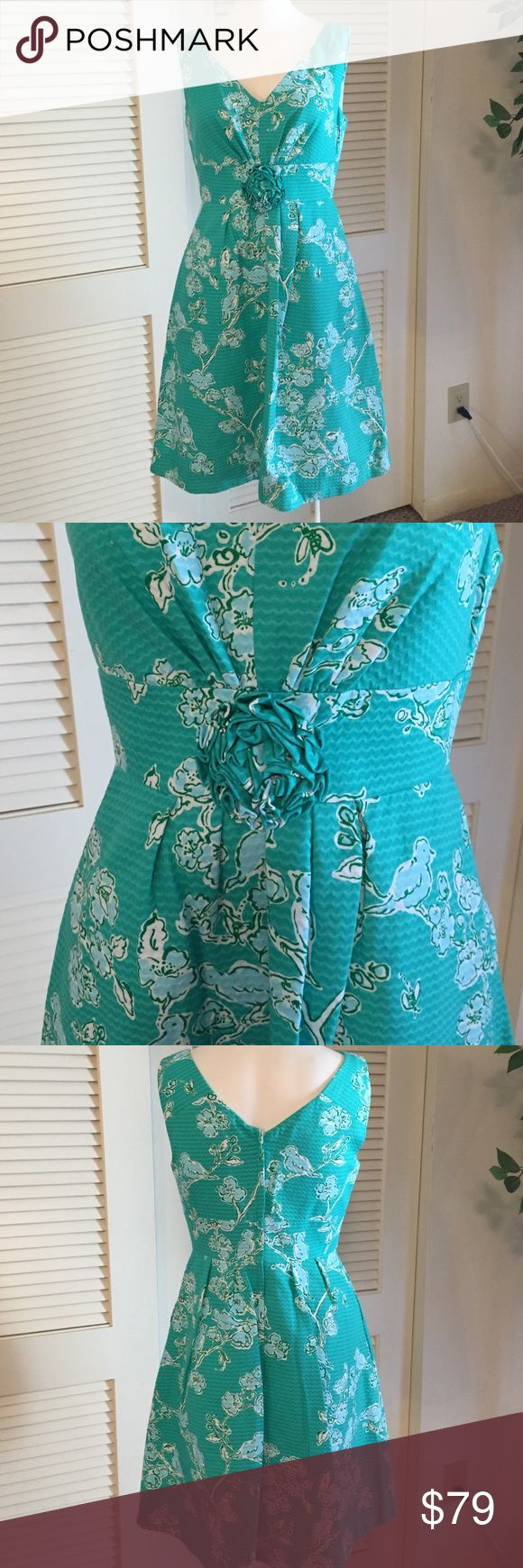 Lily Pulitzer dress Classic Lily Pulitzer dress. Mint green with light blue floral pattern. Flower at waist and pockets. So sweet 100%. Cotton Lilly Pulitzer Dresses