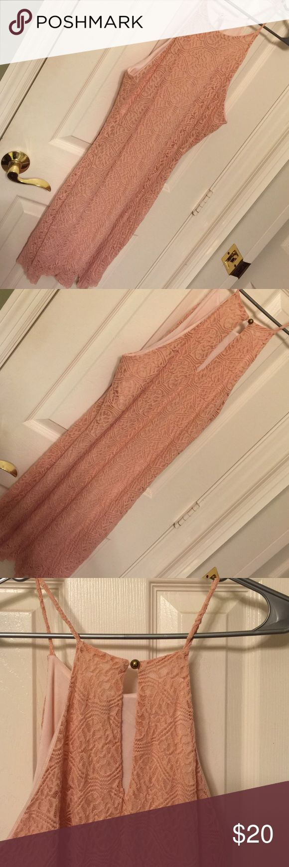 Peach lace dress. Very cute peach lacy dress. With back botton ! Worn once. Clean. Charlotte Russe Dresses