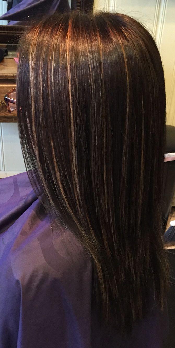 Dark brown hair, with thin blonde highlights throughout