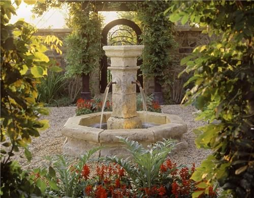 This antique French fountain serves as the centerpiece of this lush courtyard garden. Design by Studio H Landscape Architecture in Newport Beach, CA. See more courtyard gardens at: http://www.landscapingnetwork.com/front-yard-landscaping/courtyards.html