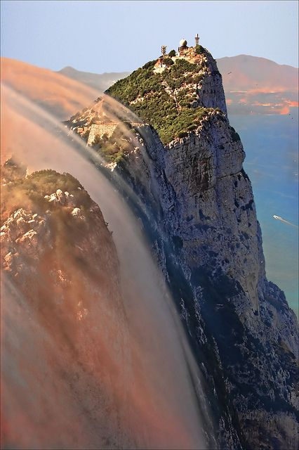 Clouds covering the walls of Gibraltar Rock, Spain.