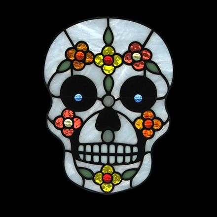 """Mexican sugar skulls are part of the holiday Dia de los Muertos or Day of the Dead when families throughout Mexico honour their deceased loved ones with offerings of food and drink. Plenty of grinding and small pieces in this stained glass pattern! Prints onto a single sheet of paper. • 6¾"""" x 9"""" • 83 pieces • level of difficulty intermediate • materials list included • grinder and ¼"""" grinding head required Download the pattern PDF after purchase!"""