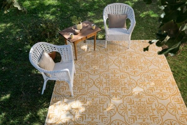 outdoor space with a gorgeous rug and vintage chairs