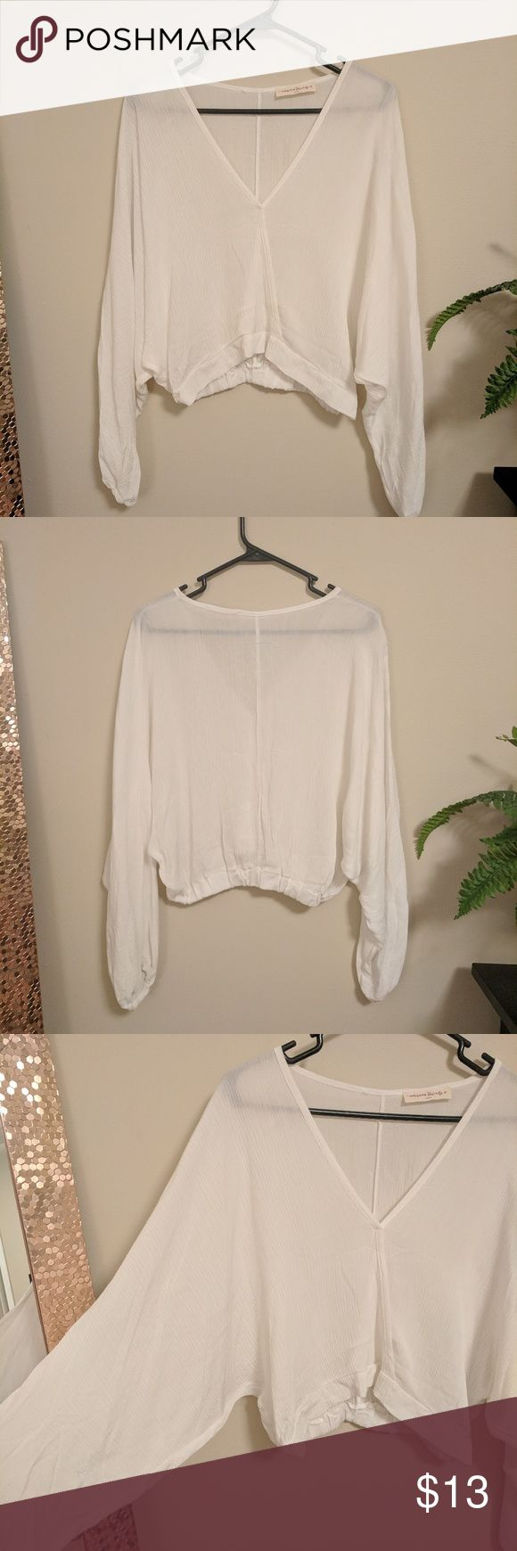 White Batwing Sleeve Crop Top White Batwing Sleeve Crop Top in size medium. New condition!  Forever 21, H&M, Charlotte Russe, Topshop, Wet Seal, American Eagle, Boohoo, ASOS, Payapa, Rue 21, Victoria's Secret, Amuse Society, Knot Sisters, Planet Blue, Show Me Your Mumu Tops